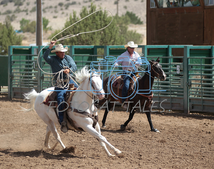 Dan and Steve Nalder compete in the double mugging event at the Minden Ranch Rodeo in Gardnerville, Nev., on Sunday, July 22, 2012..Photo by Cathleen Allison