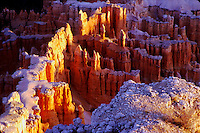 Early sunrise lights up the tops of formations at Bryce NP, Utah
