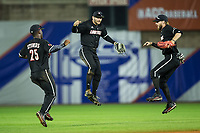 (L-R) Louisville Cardinals outfielders Josh Stowers (25), Logan Taylor (24), and Colin Lyman (35) celebrate their win over the Notre Dame Fighting Irish in Game Eight of the 2017 ACC Baseball Championship at Louisville Slugger Field on May 25, 2017 in Louisville, Kentucky.  The Cardinals defeated the Fighting Irish 10-3.  (Brian Westerholt/Four Seam Images)