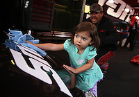 May 3, 2013; Commerce, GA, USA: Ryaah Pedregon , daughter of NHRA funny car driver Cruz Pedregon dries rain drops off the car during a rain delay to qualifying for the Southern Nationals at Atlanta Dragway. Mandatory Credit: Mark J. Rebilas-