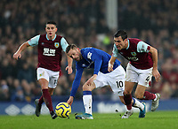 26th December 2019; Goodison Park, Liverpool, Merseyside, England; English Premier League Football, Everton versus Burnley; Jack Cork of Burnley takes on Gylfi Sigurdsson of Everton - Strictly Editorial Use Only. No use with unauthorized audio, video, data, fixture lists, club/league logos or 'live' services. Online in-match use limited to 120 images, no video emulation. No use in betting, games or single club/league/player publications
