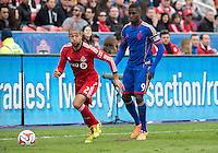 Toronto, Ontario - April 12, 2014: Colorado Rapids forward Edson Buddle #9 and Toronto FC defender Justin Morrow #2 in action during the 2nd half in a game between the Colorado Rapids and Toronto FC at BMO Field in Toronto.<br />