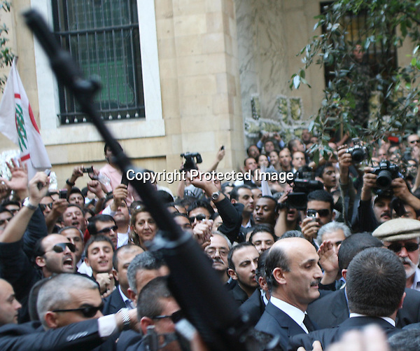 BEIRUT, LEBANON- NOVEMBER 23:Samir Geagea (R) arrives as tens of thousands of Lebanese mourners gather in Martyrs square to attend the funeral of assassinated Lebanese Industry Minister Pierre Gemayel in Beirut November 23, 2006. (Photo by Salah Malkawi)