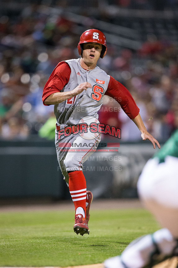 Josh McLain (28) of the North Carolina State Wolfpack hustles towards home plate against the Charlotte 49ers at BB&T Ballpark on March 31, 2015 in Charlotte, North Carolina.  The Wolfpack defeated the 49ers 10-6.  (Brian Westerholt/Four Seam Images)