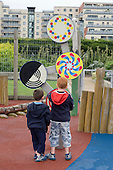 Children from a project funded by Sure Start and run by Community Childcare, play in Thames Barrier Park, Newham