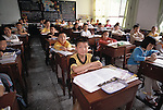 elementary, class; children at desks; boy at center; elementary school; Chongqing, China, Asia; 041603