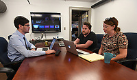NWA Democrat-Gazette/J.T. WAMPLER Ben Davis, director of operations (from the left) Casey Kinsey, CEO and Rikki Marler, client service manager, meet with a client via the internet Wednesday June 7, 2017 at software consulting company Lofty Labs in Fayetteville.