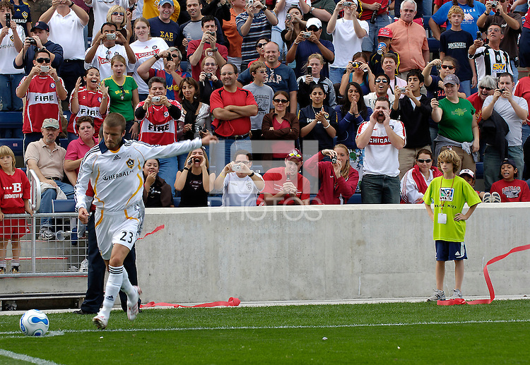 L.A. Galaxy midfielder David Beckham strikes a corner kick to the delight of onlooking fans. The Chicago Fire defeated the Los Angeles Galaxy 1-0 to secure a spot in the MLS playoffs at Toyota Park in Bridgeview, IL., on October 21, 2007.