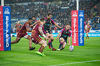 Picture by Allan McKenzie/SWpix.com - 15/03/2018 - Rugby League - Betfred Super League - Huddersfield Giants v Hull KR - John Smith's Stadium, Huddersfield, England - Hull KR's Adam Quinlan prepares to clear the ball out as Huddersfield players close in.