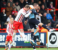Mark Hughes of Stevenage and Garry Thompson of Wycombe Wanderers in action during the Sky Bet League 2 match between Stevenage and Wycombe Wanderers at the Lamex Stadium, Stevenage, England on 17 October 2015. Photo by PRiME Media Images.