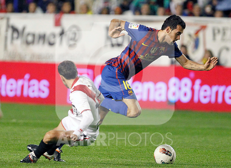 Rayo Vallecano's Roberto Trashorras (l) and FC Barcelona's Sergio Busquets during La Liga match.April 29,2012. (ALTERPHOTOS/Acero)
