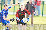Kenmare's Kevin O'Sullivan gets from Ballymac's Shane Dowling in the junior county championship quarter final at Ballymac on Sunday.