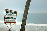Sign against sea and sky promoting The Chill Out Station. Varkala beach, Kerala, India.  No releases available.