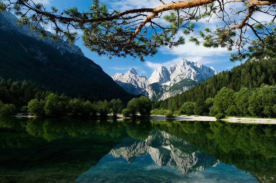 Mount Prisojnik and Mount Razor, reflected in a pond at river Pisnica<br /> view from Kranjska Gora<br /> Julian Alps<br /> Triglav National Park, Slovenia<br /> July 2009