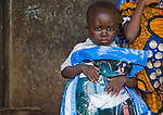 Child holding a Permanet long lasting insecticide treated mosquito net in the Garki area of Abuja, Nigeria