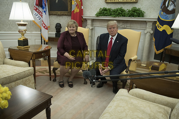 United States President Donald J. Trump, right, meets Prime Minister Erna Solberg of Norway, left, in the Oval Office of the White House in Washington, DC on Wednesday, January 10, 2018.<br /> CAP/MPI/RS<br /> &copy;RS/MPI/Capital Pictures
