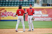 New Hampshire Fisher Cats second baseman Cavan Biggio (6) shakes hands with shortstop Bo Bichette (5) during the first game of a doubleheader against the Harrisburg Senators on May 13, 2018 at FNB Field in Harrisburg, Pennsylvania.  New Hampshire defeated Harrisburg 6-1.  (Mike Janes/Four Seam Images)