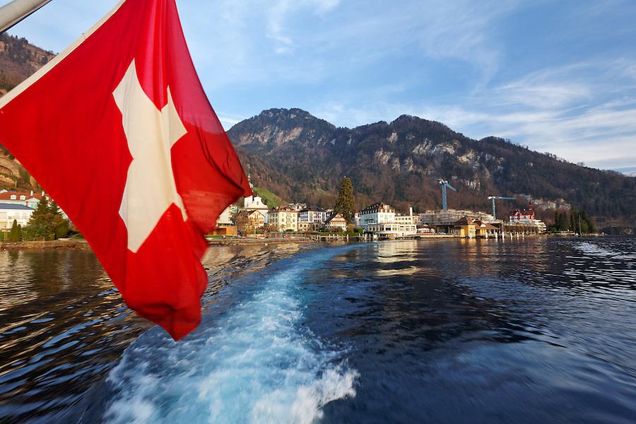 Swiss flag on tour boat cruising Lake Lucerne, Vitznau, Switzerland
