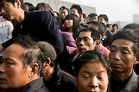 Crowds gather around the entrance to the Nanjing Massacre Memorial Museum in Nanjing, Jiangsu, China, on the 71st Anniversary of the start of the Rape of Nanjing.