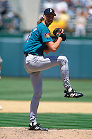 OAKLAND, CA - Randy Johnson of the Seattle Mariners in action during a game against the Oakland Athletics at the Oakland Coliseum in Oakland, California in 1994. Photo by Brad Mangin