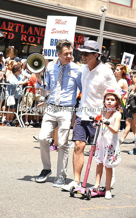 State Senator Brad Hoylman and husband attends the New York City Gay Pride March 2016 on June 26, 2016 on Fifth Avenue in New York City, New York, USA.<br /> <br /> photo by Robin Platzer/Twin Images<br />  <br /> phone number 212-935-0770