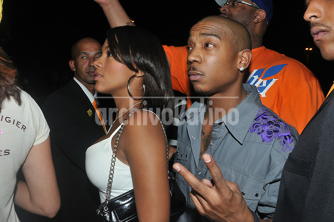 American rapper Ja Rule leaves the disco People in Rio de Janeiro, Brazil,  with  Ines Carolina, his Brazilian friend.