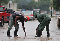 Private workers clean a drain while Tropical Storm Emily moves through Dominican Republic and Haiti;  the Tropical Storm Emily dissipated Thursday afternoon , but could regenerate in the next few days, according to the National Hurricane Center.  August 4, 2011 VIEWpress/  Kena Betancur