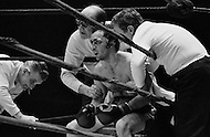 11 May 1970, Manhattan, New York City, New York State, USA. Boxer Marcel Cerdan Jr. receives quick medical treatment and advice between rounds of his bout with Donato Paduano at Madison Square Garden. Paduano defeated Cerdan Jr. Image by © JP Laffont