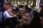 The Chairman of the Joint Chiefs of Staff General Richard B. Myers looks over some briefings while United States Secretary of Defense Donald H. Rumsfeld does the same aboard a Texas Air National Guard C-130E headed for Baghdad, Iraq, on May 13, 2004.  Rumsfeld and Myers are traveling to Southwest Asia to visit the troops in Baghdad.   <br /> Mandatory Credit: Jerry Morrison / DoD via CNP