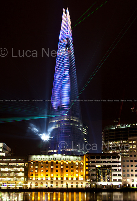"""London, 05/07/2012. The tallest skyscraper of Western Europe (309.6 meters - 1,016 ft), """"The Shard"""", was inaugurated today (using a large laser light show) in London Bridge area. The 72 habitable floors building was designed in 2000 by the Italian architect Renzo Piano and founded by a consortium of Qatari investors."""
