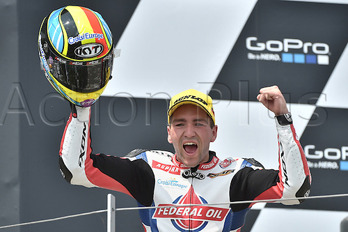 12.07.2015. Sachsenring, Germany MotoGP.  Moto2 Gopro Motorrad Grand Prix Germany.  Belgian Moto2 rider Xavier Simeon of Federal Oil Gresini Moto2 cheers on the podium after winning the Motorcycle World Championship Grand Prix of Germany at the Sachsenring racing circuit in Hohenstein-Ernstthal, Germany, 12 July.