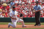 June 20, 2010       St. Louis Cardinals first baseman Albert Pujols (5) juggles the ball from one hand to the other after making the out on a pickoff throw from the pitcher on Oakland Athletics right fielder Ryan Sweeney.  At right is first base umpire, Rob Drake.  The St. Louis Cardinals lost 3-2 to the Oakland Athletics in the final game of a three-game homestand at Busch Stadium in downtown St. Louis, MO on Sunday June 20, 2010.