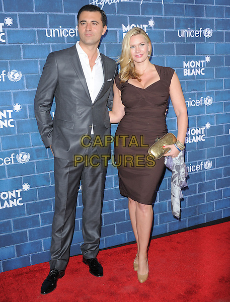 Darius Campbell & Natasha Henstridge.at The Montblanc and UNICEF Pre-Oscar Brunch to Celebrate Their Limited Edition Collection with Special Guest Hilary Swank held at Hotel Bel Air in Beverly Hills, California, USA, .February 23rd 2013..full length brown dress gold clutch bag couple grey gray suit white shirt .CAP/DVS.©Debbie VanStory/Capital Pictures.