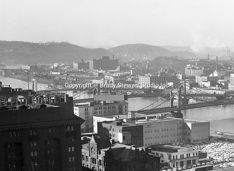 Pittsburgh Pa:  View of the North Side and bridges from the Penn Station roof - 1959.  View includes the 6th, 7th and 9th street bridges and Fort Pitt Hotel.