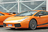A bright orange Lamborghini Gallardo LP 570-4 Superleggera sportscar.