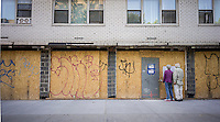 Plywood hides the renovation of a storefront in Greenwich Village in New York on Tuesday, August 27, 2013. (© Richard B. Levine)