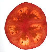 Sliced tomato on white background