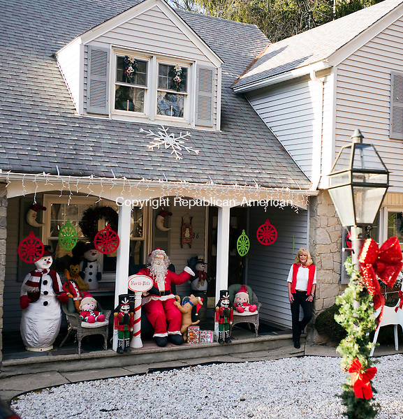 Waterbury, CT- 16 December 2015-121615CM06- Bonnie Gentile stands outside her Waterbury home on Wednesday.  Gentile said she spent about 20 hours decorating her home for Christmas.    Christopher Massa Republican-American