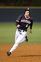 Ben Arkin (6) of the Davidson Wildcats rounds third base against the Wake Forest Demon Deacons at Wilson Field on March 19, 2014 in Davidson, North Carolina.  The Wildcats defeated the Demon Deacons 7-6.  (Brian Westerholt/Four Seam Images)