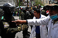 Health sector profesionals protest clash with police while  demanding the repeal of a new law which would penalise medical professionals who cause health or bodily harm through negligence or malpractice.The new punishments include: five to nine years of imprisonment, the suspension of a professional title and the seizure of assets. <br /> Talks with the government of President Evo Morales about the new law have crumbled.