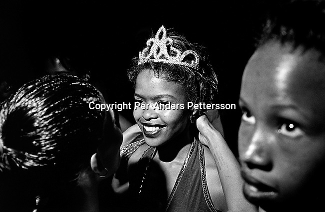 An unidentified girl is crowned at a beauty pageant on February 9, 2002 in Loisevale, Upington, South Africa. Loisevale, a poor and destitute colored township where unemployment is high. It has many social problems including domestic violence and alcohol abuse. Baby Thsepang, an 8-month old baby was raped here by her father in 2001. The baby rape shocked the country. It's struggling with an increase of rapes and abuse of young children. The country has the highest number of rapes in the world. (Photo by: Per-Anders Pettersson)...