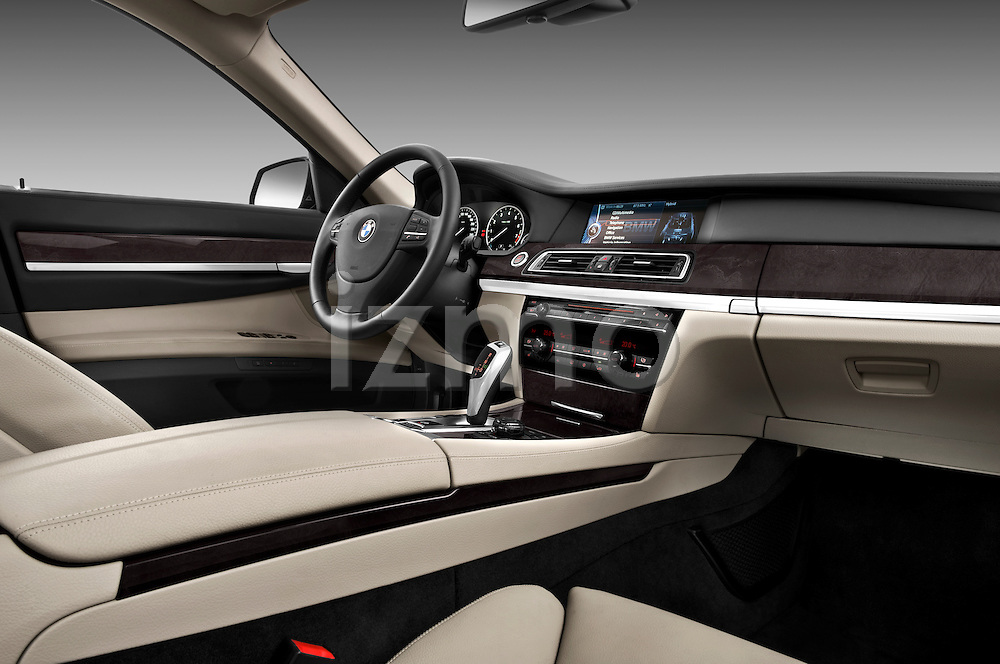 Passenger side dashboard view of a 2011 BMW 7 Series Active Hybrid.