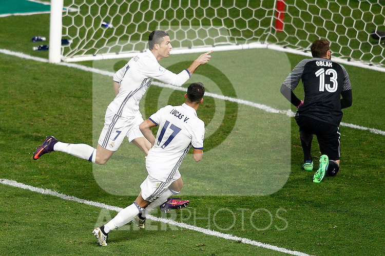 Real Madrid's Cristiano Ronaldo (l) and Lucas Vazquez (c) celebrate goal in presence of Atletico de Madrid's Jan Oblak during La Liga match. November 19,2016. (ALTERPHOTOS/Acero)