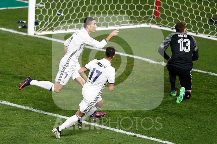 Real Madrid's Cristiano Ronaldo (l) and Lucas Vazquez (c) celebrate goal in presence of Atletico de Madrid's Jan Oblak during La Liga match. November 19,2016. (ALTERPHOTOS/Acero)