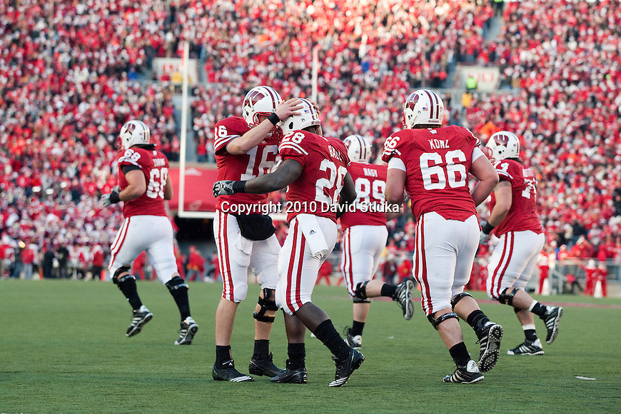 Wisconsin Badgers quarterback celebrates running back Montee Ball (28) touchdown run during an NCAA college football game against the Northwestern Wildcats on November 27, 2010 at Camp Randall Stadium in Madison, Wisconsin. The Badgers won 70-23. (Photo by David Stluka)