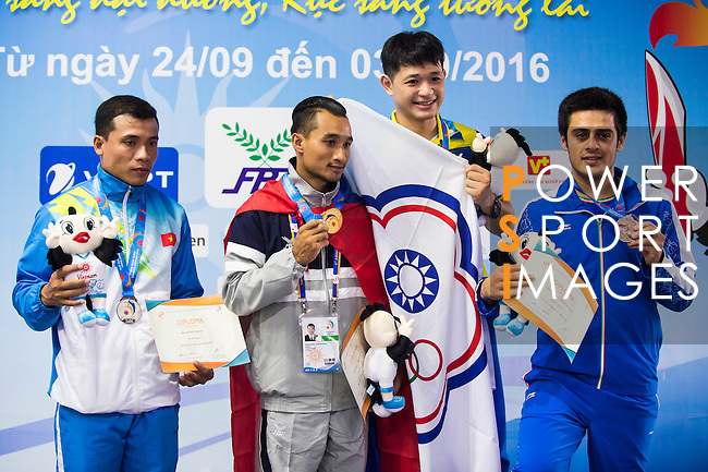 Prize presentation ceremony of the Vovinam Men Five Gate Form on Day Eight of the 5th Asian Beach Games 2016 at Bien Dong Park on 01 October 2016, in Danang, Vietnam. Photo by Marcio Machado / Power Sport Images