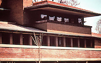 Frank Lloyd Wright:  Robie House, Oak Park IL,, 1909. Prairie style with cantilevered roof and stained glass windows. (Photo Feb. 1988.)