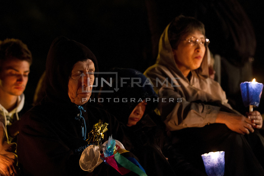 Pilgrims seen here during an evening vigil ahead of the beatification of Pope John Paul ll.
