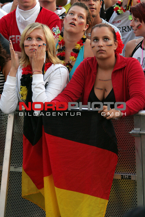 FIFA WM 2006 - Feature Fanmeile Berlin<br /> Play #63 (08-Jul) - Germany vs Portugal.<br /> Female Supporters from Germany celebrate prior to the match Germany against Portugal at Brandenburger Tor in Berlin.<br /> Foto &copy; nordphoto
