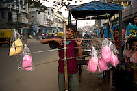 portrait of a child selling candy floss door-to-door, Nagaland